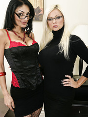 Blonde Nikkita James and brunette Persia Pele playing hot lesbian games together