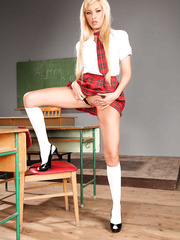 Glamorous and gorgeous blonde schoolgirl Donna Bell strips in the classroom