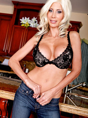 Busty blonde milf Puma Swede takes off beautiful lingerie and spreads her ass