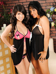 Black haired buxom lesbians Layla Rose and Nina Mercedez using a strapon toy