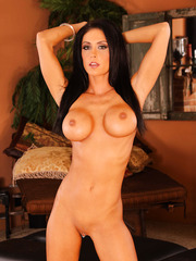 Dark haired angel Jessica Jaymes demonstrates her tanned body and a shaved pussy