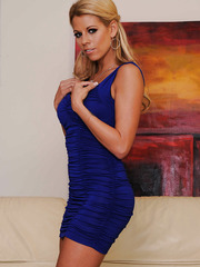 Passionate babe Nicole Graves looks amazing while she takes off her sexy dress