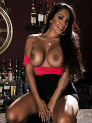 Tanned brunette Nina Mercedez shows her big boobs and masturbates with her fingers