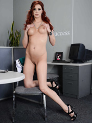 Redhead business woman Jayden Cole presents her perfect tits and shaved pussy