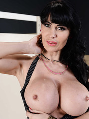 Horny MILF Eva Karera with big tits and shaved cunt showing her body
