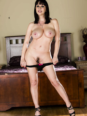Astonishing brunette MILF RayVeness showing her body naked on a bed