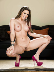 Charming MILF Courtney Cummz likes to pose while wearing her high-heels