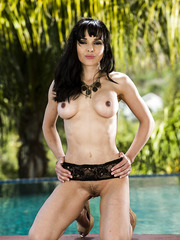 Ravishing brunette MILF Cytherea undressing her sexy lingerie on the pool