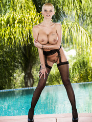 Remarkable MILF Joslyn James showing her big tits and spreading her legs