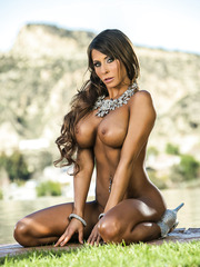 Lovely MILF Madison Ivy spreading her legs and showing her big tits