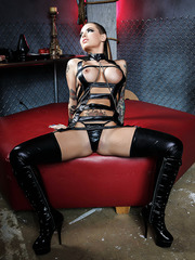 Latex MILF Christy Mack showing her lovely tattoos and her big tits