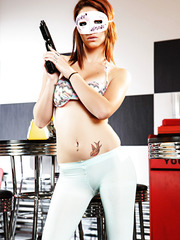 Remarkable babe Kiera Winters showing her boobs while holding a gun