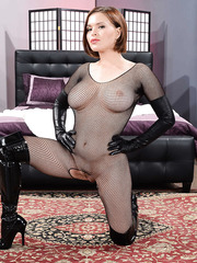 Alluring MILF Catie Parker wearing some fishnet clothes and posing