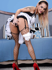 Busty babe Devon pretending to be a maid and shows her big tits.