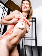 Wonderful MILF Miss Melrose showing her hairy pussy and her nice boobs