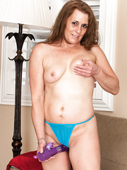 Chubby mature slut Cristine Ruby playing with her favorite dildo at home