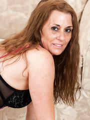 Mature slut Cristine Ruby wearing some sexy lingering undressing at home