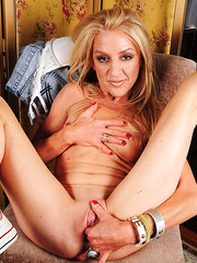 Winsome mature slut Ava showing her shaved cunt and posing for camera