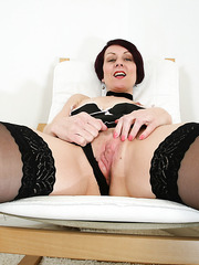 Alluring mature whore Penny Brooks using a dildo to please her cunt