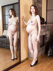 Pregnant MILF Iviola showing her shaved cunt and posing for the camera