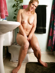 Ravishing blonde MILF Trish revealing her hairy pussy and her horny mood