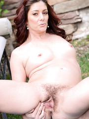 Appealing MILF Alicia Silver showing her amazing body naked outdoors