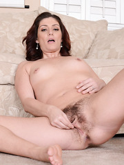 Sparkling MILF Alicia Silver getting naked and playing with hairy twat
