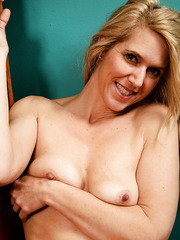 Entrancing MILF Trish getting naked and horny and showing some flesh