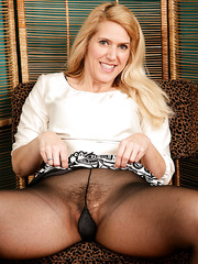 Horny MILF Trish posing for the camera and showing her hairy pussy
