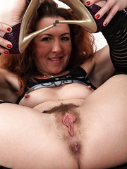 Mesmerizing mature Elizabeth rips her stockings and shows her hairy twat