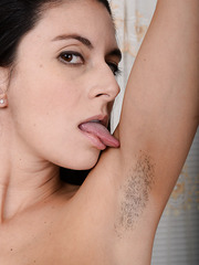 Unforgettable babe Nikki Daniels showing her hairy pussy while spreading