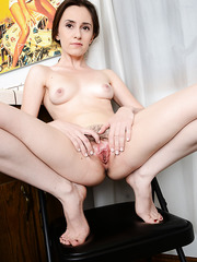 Adorable MILF Natalia M spreading her legs wide and showing some pussy