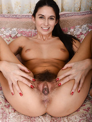 Ravishing slut with a very hairy pussy Nikki Daniels posing for camera