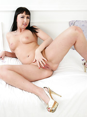 Naughty and horny Tracey Lain doing an eye-catching striptease here