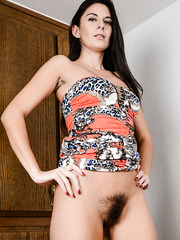 Hairy brunette MILF Nikki Daniels showing her cunt and her nice boobs