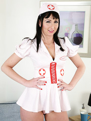Sparkling nurse Tracey Lain with her amazing ass posing almost naked