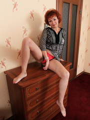Hairy mature redhead Julia showing her naked body and posing for camera