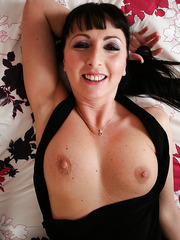 Appealing MILF Tracey Lain showing her tits and playing with her cunt