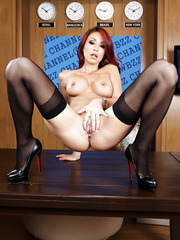 Beautiful redhead MILF Monique Alexander with big tits spreading her legs