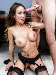 Alluring babe Sandee Westgate showing her big tits and doing a blowjob