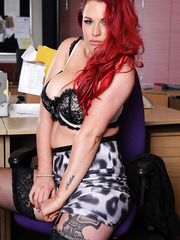 Seductive redhead MILF Paige Delight with her big tits posing for camera