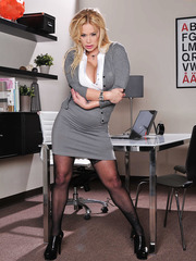 Insanely spicy milf Pornstar Shyla Stylez poses naked in stockings