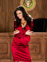 Glamorous secretary milf Veronica Avluv takes off her red dress to show her boobs