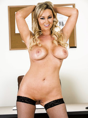 Abbey Brooks poses with naked boobies and spread legs on the table
