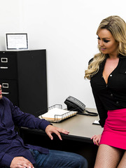 Awesome blonde secretary Abbey Brooks is getting her boobies covered with cum