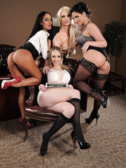 Four sweeties are posing in the office just to show their naked bodies