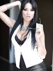 Slender secretary milf Anissa Kate is getting naked in her stockings