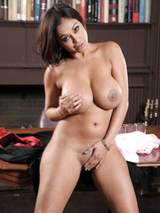 Stunning tanned mature Priya Anjali Rai shows off her big boobies