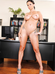 Alluring milf with tattoos Jewels Jade shows her wide-opened pussy