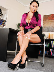 Alluring perverted milf Mariah Milano shows her nice big tits in the office